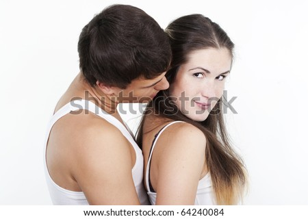 Portrait of a beautiful young happy smiling couple - stock photo