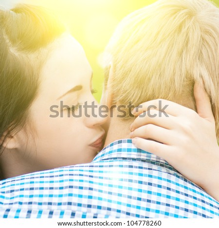Portrait of a beautiful young happy smiling couple - hugging with love - stock photo