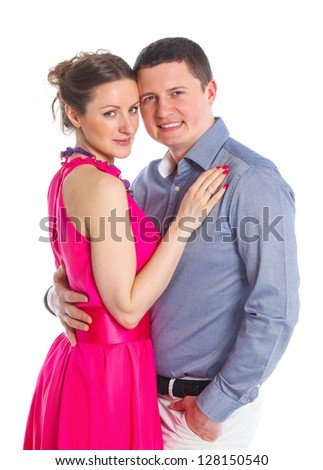 Portrait of a beautiful young happy smiling couple. Isolated white backround - stock photo