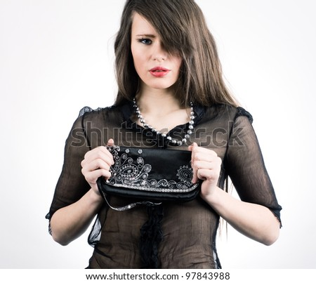 Portrait of a beautiful young lady. Fashion photos. - stock photo