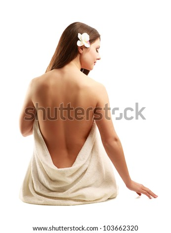 Portrait of a beautiful young lady with a towel