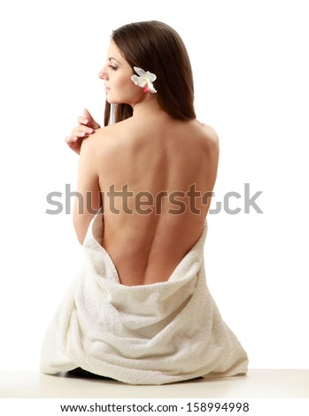 Portrait of a beautiful young lady with a towel, isolated on white background