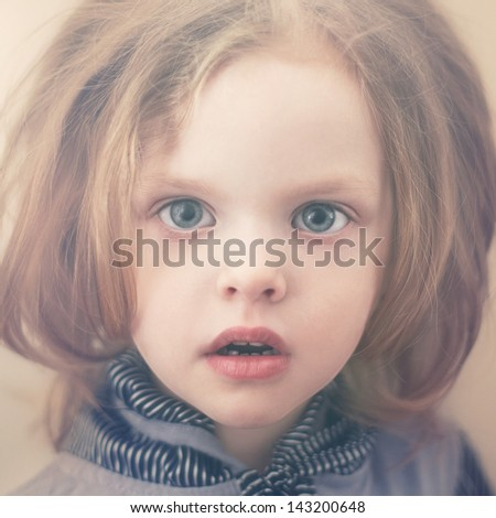 portrait of a beautiful young lady with curly blonde hair - stock photo
