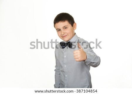 Portrait of a beautiful young man giving you thumbs up, child, on white background