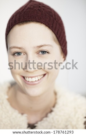portrait of a beautiful young natural woman with a cap