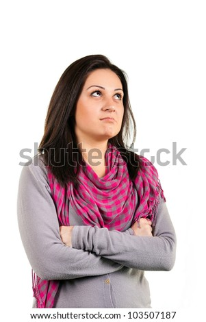 Portrait of a beautiful young pensive brunette, wearing  pink scarf on white background