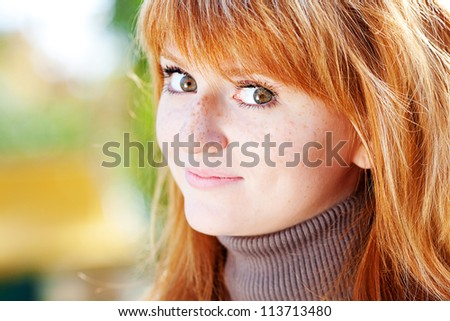 portrait of a beautiful young redhead teenager woman