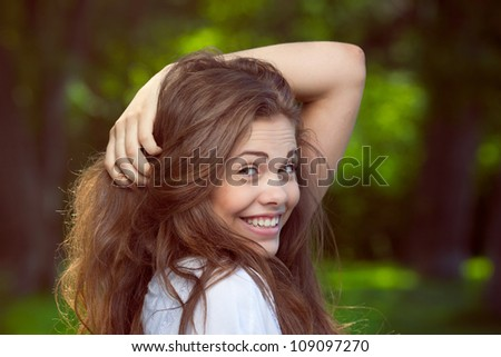 Portrait of a beautiful young smiling girl - stock photo