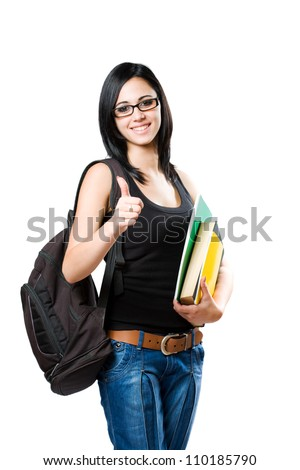 Portrait of a beautiful young student girl showing thumbs up isolated on white background. - stock photo