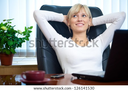 Portrait of a beautiful young successful businesswoman in the workplace - stock photo