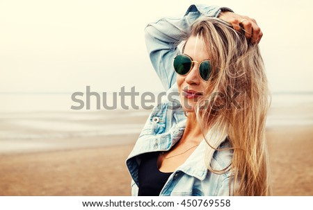 Portrait of a beautiful young Tanned girl on a sunny day in the summer on the beach. Travel and vacation concept. - stock photo