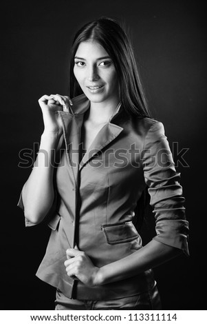 Portrait of a beautiful young woman against black background