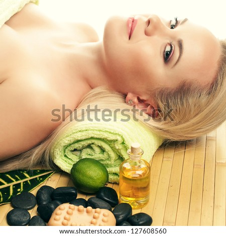 Portrait of a beautiful young woman at a spa salon. Perfect Skin. Skincare. Young Skin - stock photo
