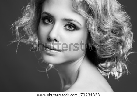 Portrait of a beautiful young woman black and white - stock photo
