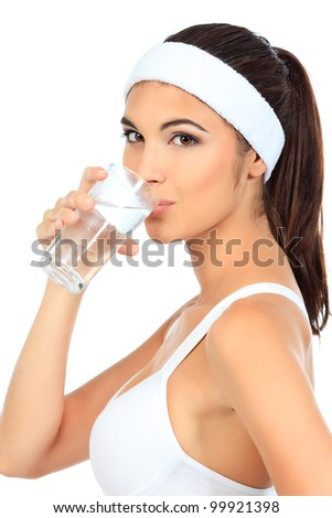 Portrait of a beautiful young woman drinking clear water. Isolated over white background.