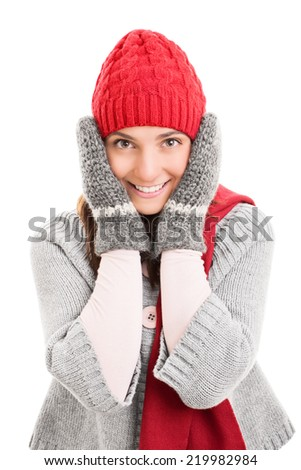 Portrait of a beautiful young woman holding her head wearing winter clothes isolated on white background