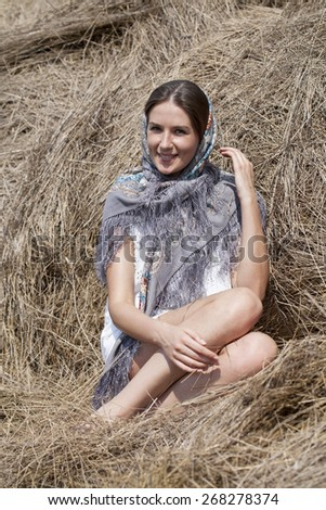 Portrait of a beautiful young woman in a blue scarf on the background of the loft - stock photo