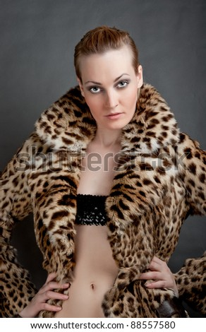 Portrait of a beautiful young woman in a fur.