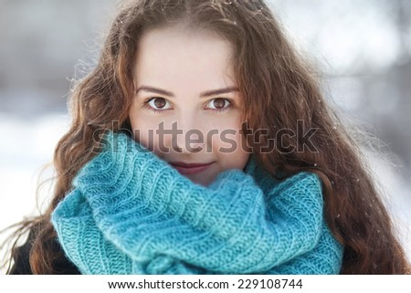 portrait of a beautiful young woman in a scarf  - stock photo