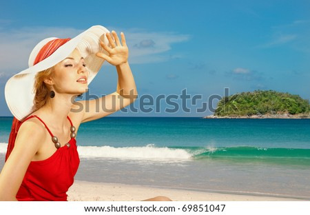 portrait of a beautiful young woman in a white hat - stock photo
