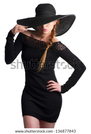 Portrait of a beautiful young woman in black hat isolated on white
