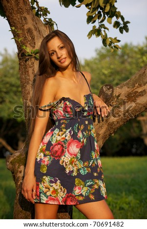 Portrait of a beautiful young woman in garden
