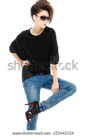 Portrait of a beautiful young woman in jeans posing - stock photo