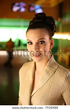 Portrait of a beautiful young woman indoors. Shallow DOF, focus on eyes. - stock photo