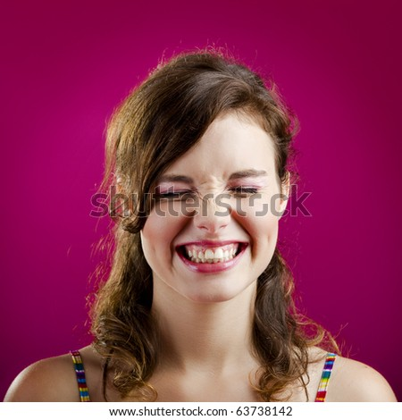 Portrait of a beautiful young woman laughing - stock photo