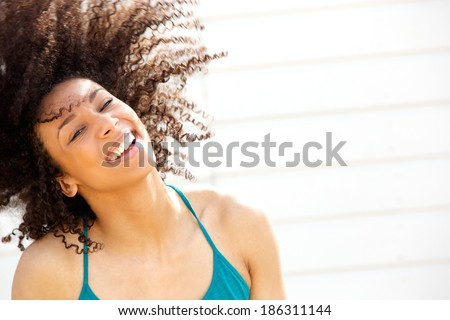 Portrait of a beautiful young woman laughing and enjoying summer - stock photo