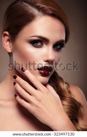 Portrait of a beautiful young woman. Modern makeup. The hand near the face. - stock photo