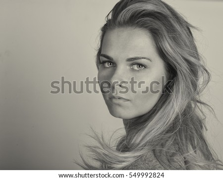 Portrait Of a Beautiful Young woman On Grey