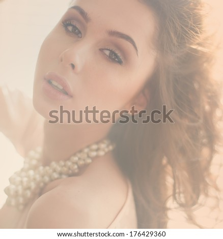 portrait of a beautiful young woman. photo in soft light - stock photo