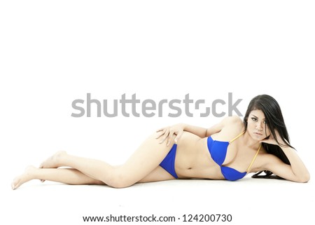 portrait of a beautiful young woman posing in bikini. Isolated over white background