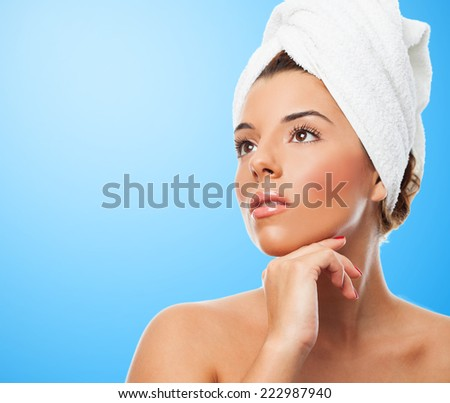 portrait of a beautiful young woman receiving beauty treatment
