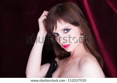 Portrait of a beautiful young woman, red background - stock photo