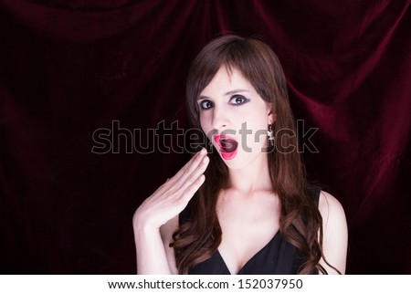 Portrait of a beautiful young woman, red background