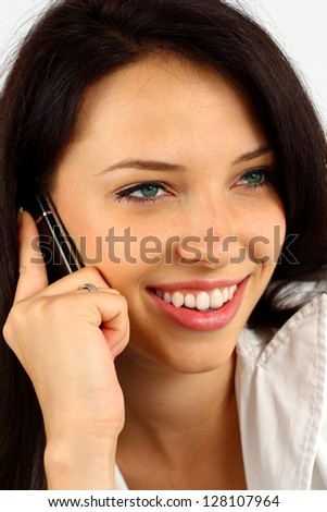 Portrait of a beautiful young woman talking on her phone - stock photo