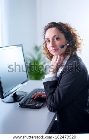 portrait of a beautiful young woman telephone operator