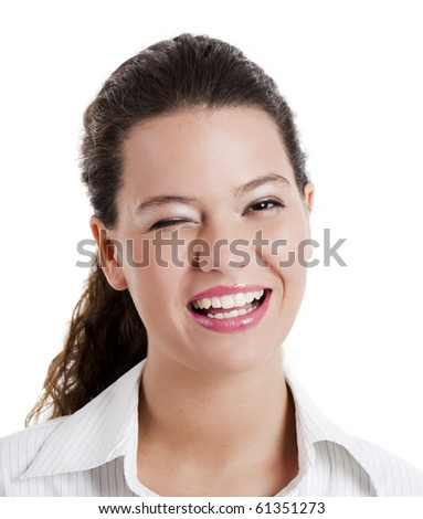 Portrait of a beautiful young woman winking - stock photo