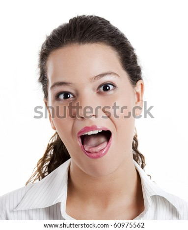 Portrait of a beautiful young woman with a expression of surprise - stock photo