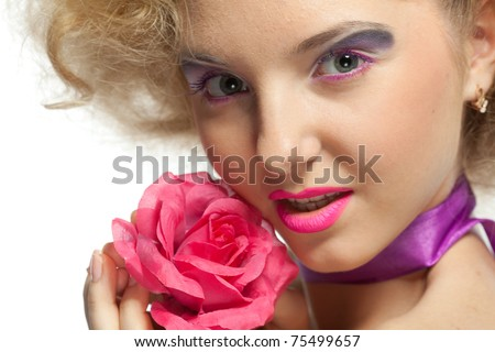 Portrait of a beautiful young woman with a flower on a white background.