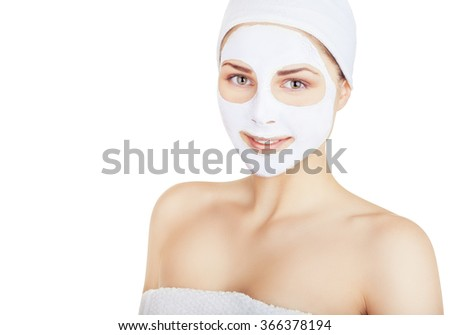 Portrait of a beautiful young woman with a white mask on his face. Isolated on white background - stock photo