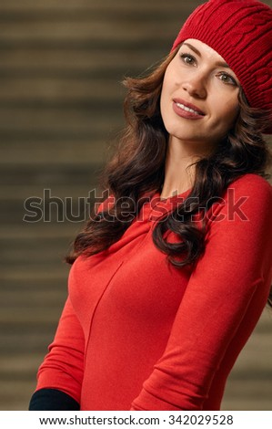 Portrait of a beautiful young woman with background stairs outdoors. beautiful young woman smiling. wearing red dress, beret, black gloves - stock photo