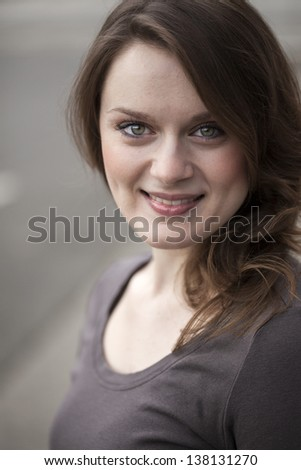 Portrait of a beautiful young woman with beautiful green eyes and brown hair. - stock photo