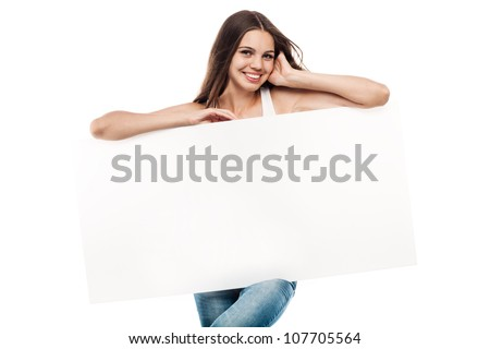 Portrait of a beautiful young woman with blank billboard isolated on white background - stock photo