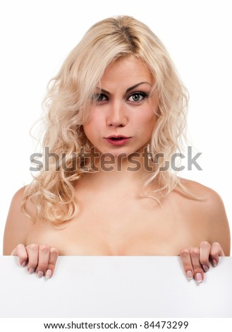 Portrait of a beautiful young woman with blank billboard on white background - stock photo