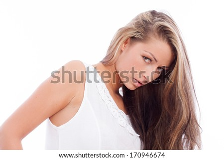 Portrait of a beautiful young woman with brunette hair on white background
