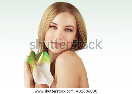 Portrait of a beautiful young woman with calla flower over clean background, healthy lifestyle, beauty treatment, enjoying dayspa - stock photo
