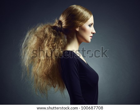 Portrait of a beautiful young woman with curly red hair. Fashion & Beauty - stock photo